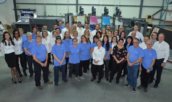 Staff in front of the new press