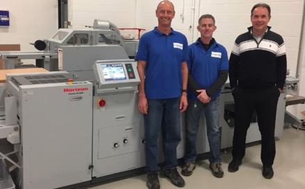 left to right, Warren Bryant and Dane Edgley operators at InvestorCom, and Steve Klaric, sales manager at KBR Graphics.